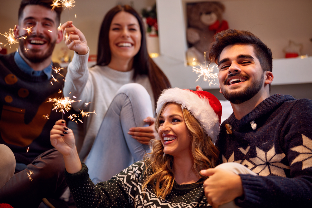 Friends celebrating, holiday party tips success