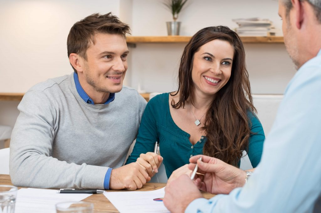Couple learning about conventional home loans