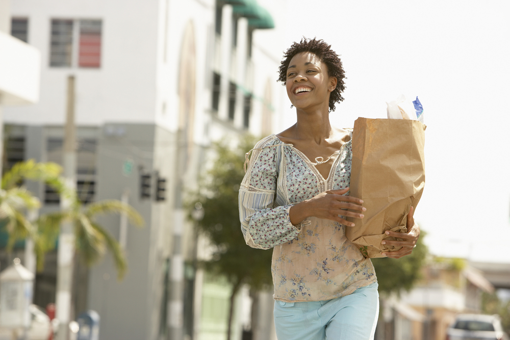 Best ways to save money on groceries, women carrying groceries